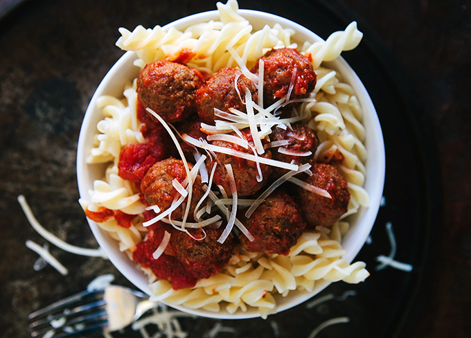 Slow Cooker Meatballs - Delicious homemade meatballs and sauce, made so much easier in the crock pot. Family dinner, party appetizer, and more!