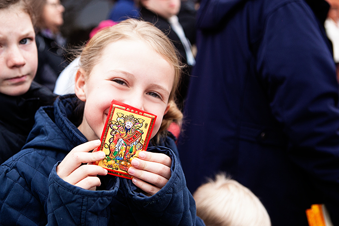 Girl holding a lucky card at a Chinese New Year Festival