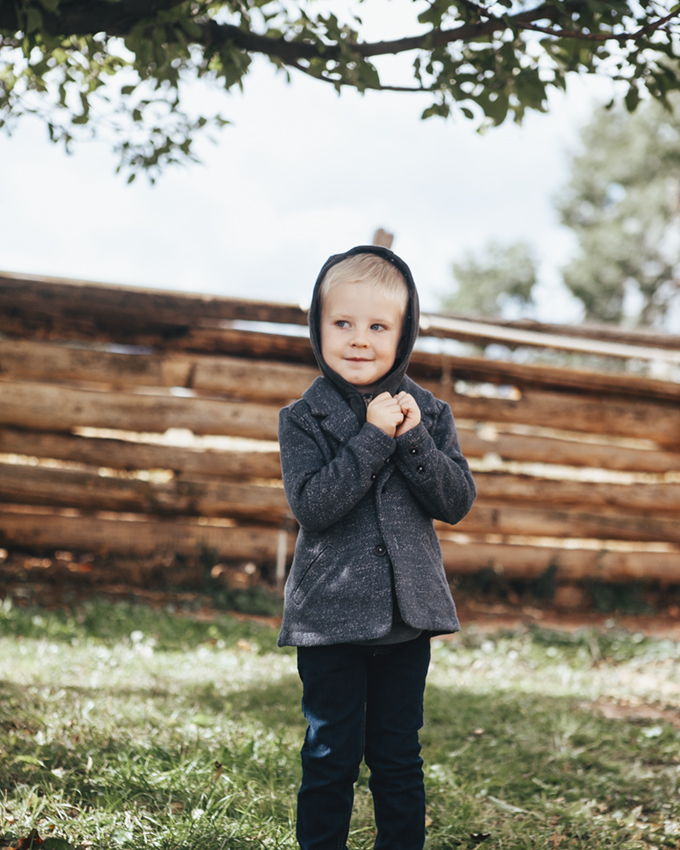 little boy in hooded jacket