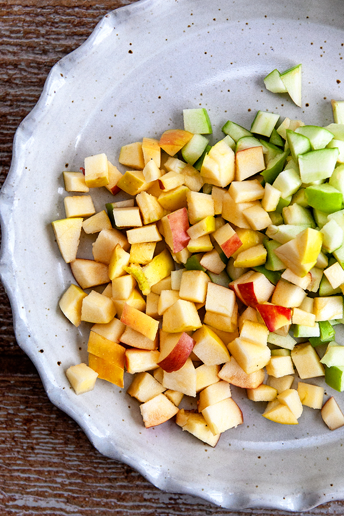 chopped red and green apples in a pie plate
