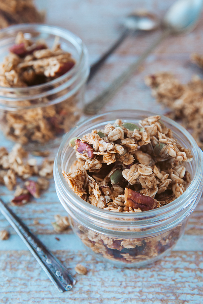 Close up shot of a jar filled with homemade pumpkin granola