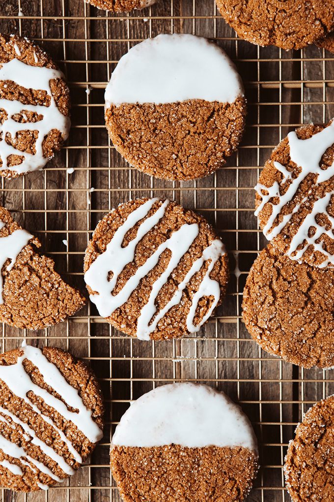 Closeup of ginger cookies with icing on a baking rack