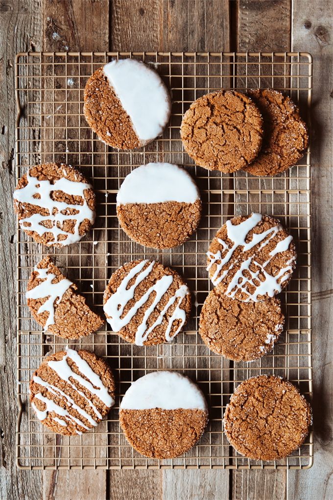 a dozen spiced ginger cookies with lemon glaze on a wire baking rack