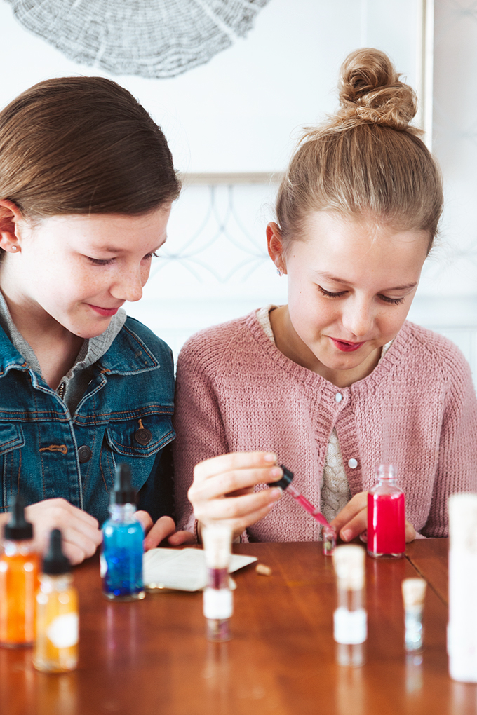 2 girls using a Potion Making Kit for Kids