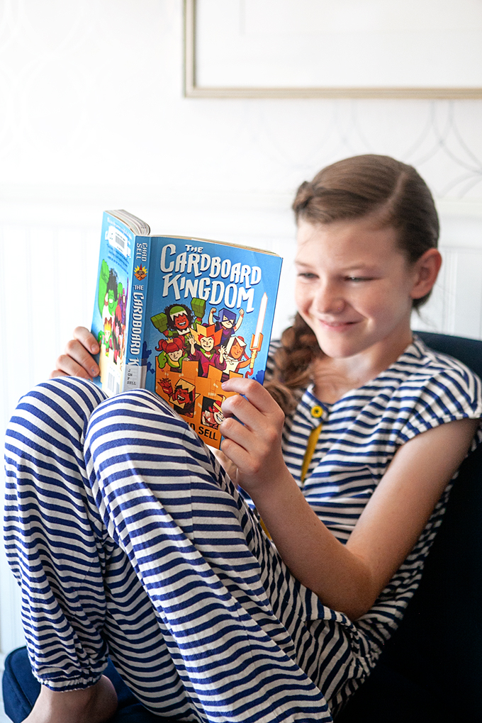 girl reading a graphic novel for tweens