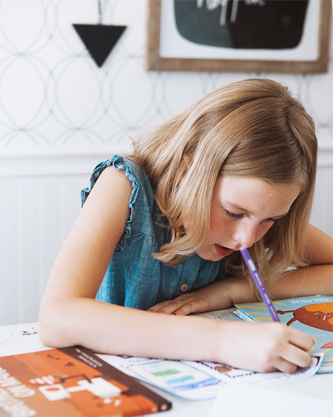 girl drawing on a worksheet