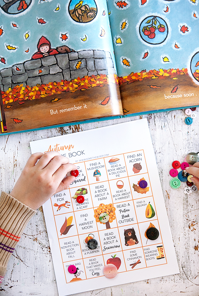 child placing buttons on an Autumn Picture Book Bingo Card