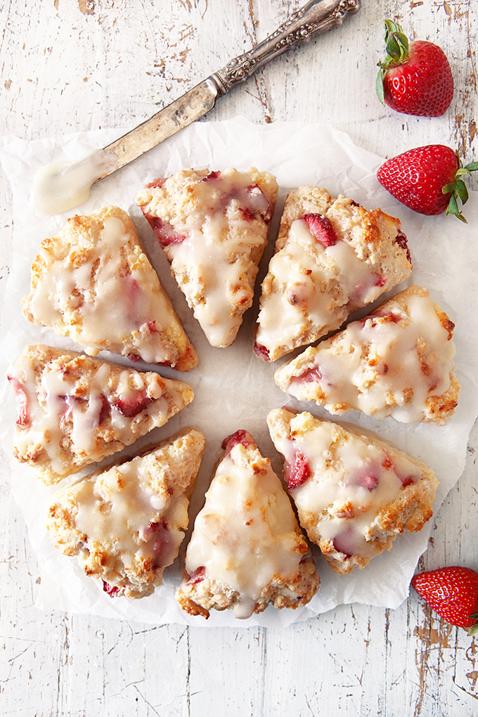 Glazed Fresh Strawberry Scones on parchment paper