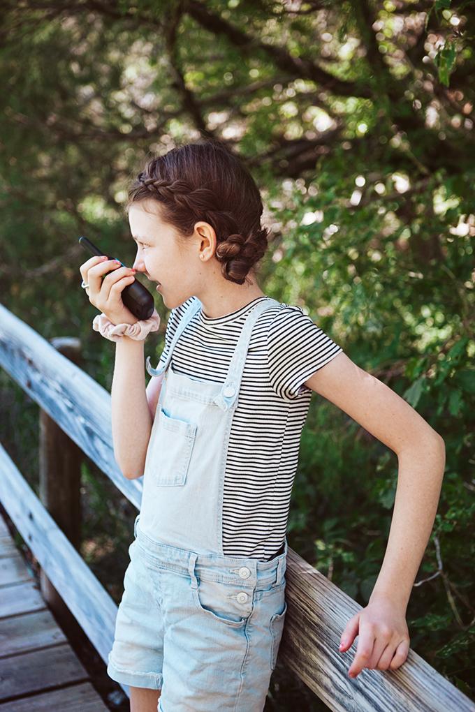 Girl talking into a walkie talkie