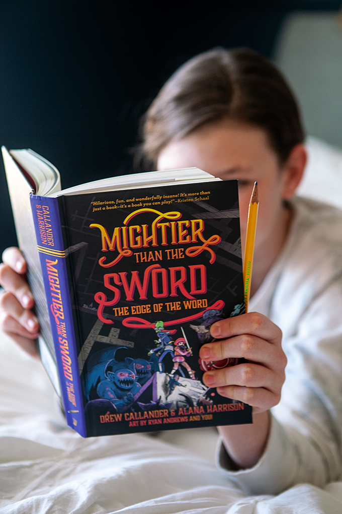 Girl reading Mightier than the Sword