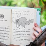 illustration of a sloth on a tree branch in the book Maybe Maybe Marisol Rainey